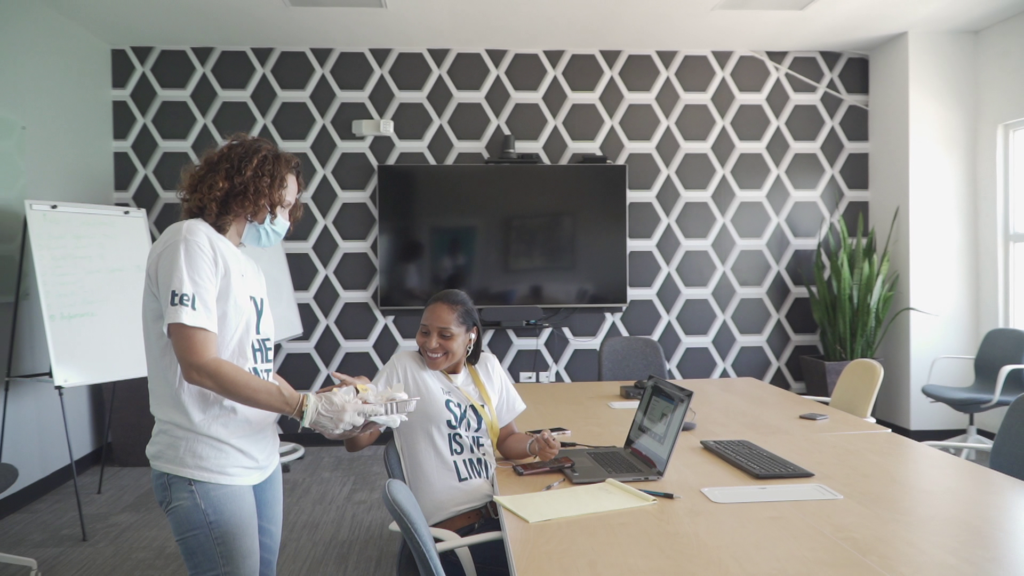 Our Chief Marketing Officer, Melissa von Frankenberg, handing out branded cupcakes to an onsite employee in one of our modern, spacious meeting rooms, during the Big Brand Reveal Week.